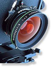 ۱۸۰px-Large_format_camera_lens[1]
